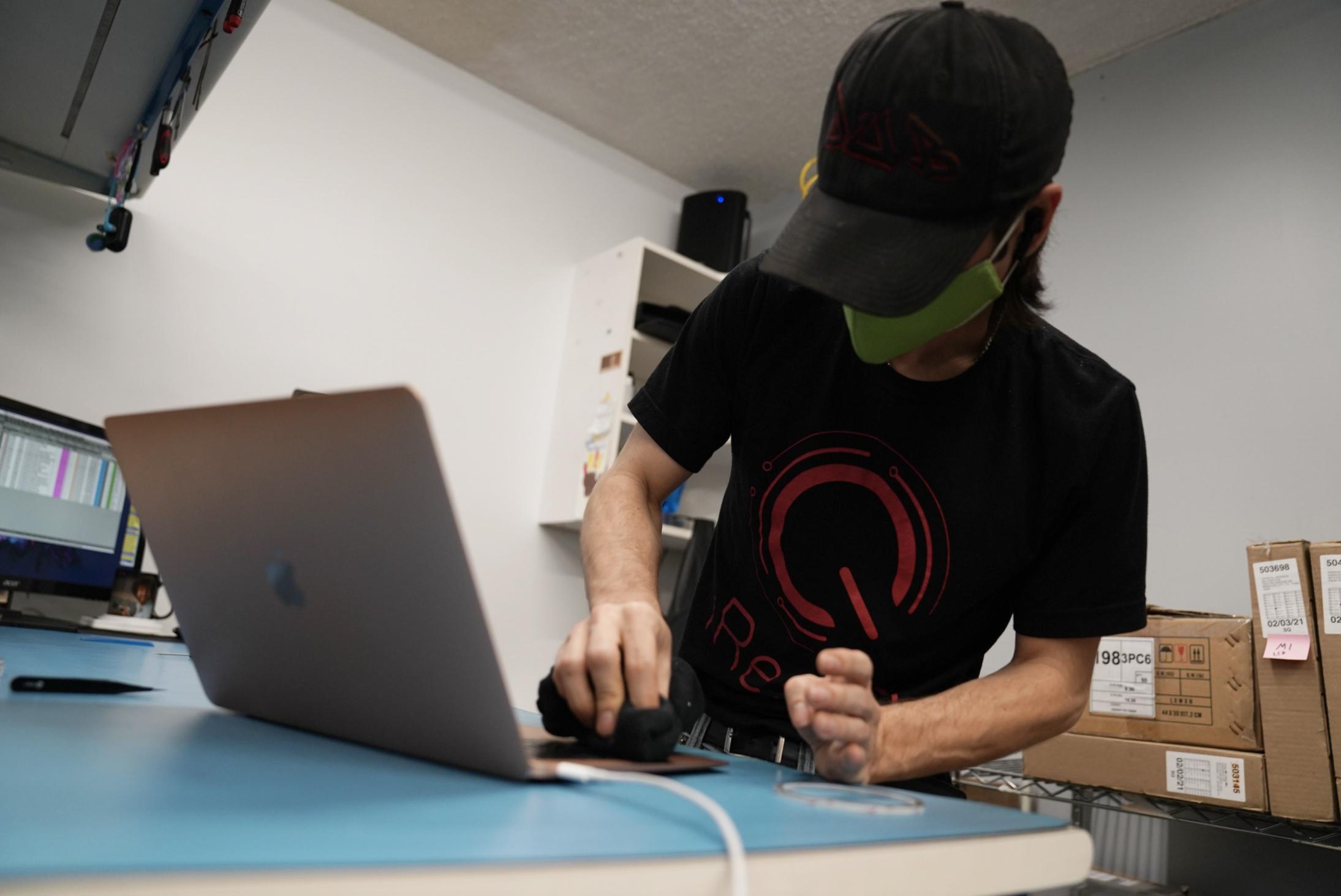 iresQ employee working on laptop